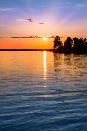 tranquil view of a beautiful sunset in Sweden one evening in July Stock Photo
