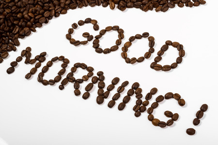 coffee beans and good morning text written with beans on a white background Zdjęcie Seryjne