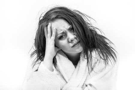 studio picture of a woman who is tired and feeling bad