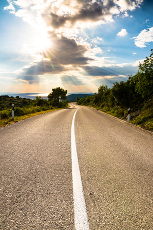 heading into the sunset on an empty road in southern Europe