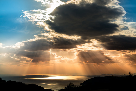 dramatic sunset over the Mediterranean sea on a summer evening Stock Photo