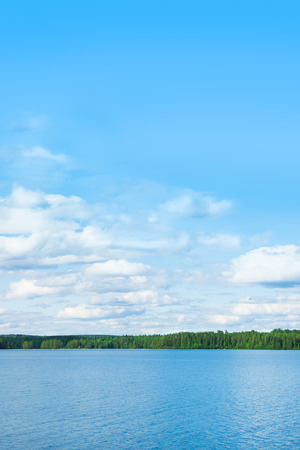image of lake and sky in Sweden with a lot of space for text