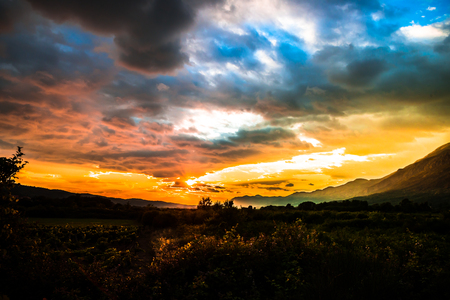 magical sunset over a valley with mountains around in southern Europe