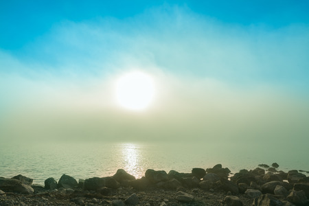 soft background image on a quiet morning with with mist and sun over sea Stock Photo