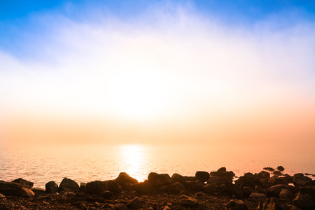 perfect background image on a magical morning with the sun and the fog in front
