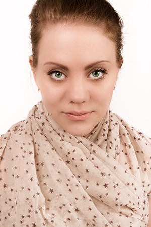 beautiful green eyed woman who looks straight into the camera in a studio