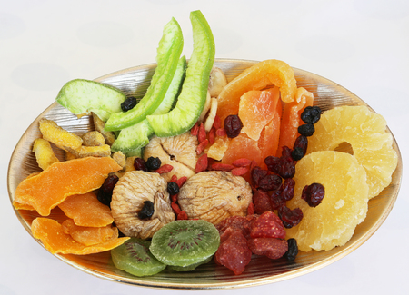 In the bowl of dried fruit on