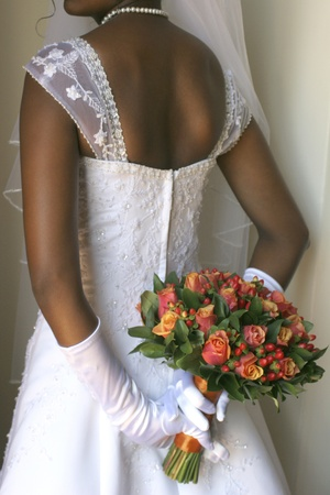 bride holding bouquet behind her Stock Photo