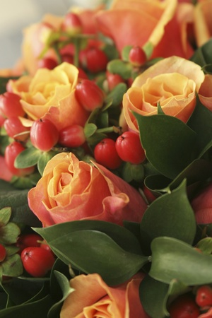 Orange and red bouquet of roses