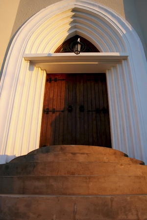 steps leading to arched curch door