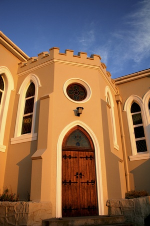 Arched church door against blue sky Stock Photo