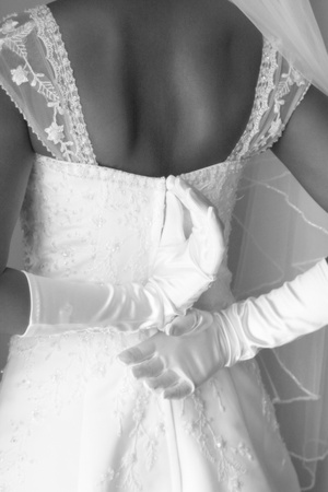 bride adjusting wedding dress Stock Photo
