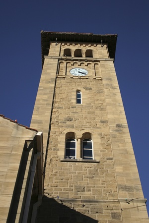 Limestone clock tower against blue sky, South Africa Stock Photo