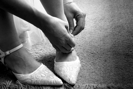 Bride fitting shoes on her wedding day Stock Photo - 8890257