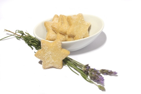 Isolated image of star shaped cookies in white bowl with purle lavender Stock Photo