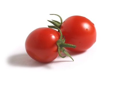 Two bright red tomatos with on white background Stock Photo