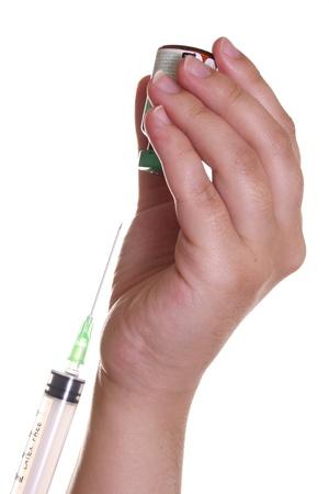 Nurses hands at the brink of filling a syringe