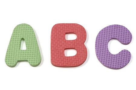 Colorful abc foam letters on a white background Stock Photo