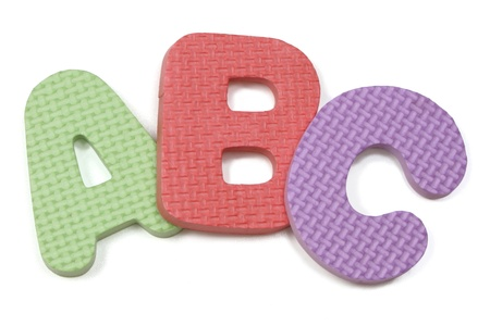 Colorful arched ABC foam letters ons white background