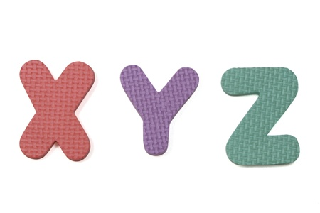 xyz: Colorful Foam XYZ on placed white background Stock Photo