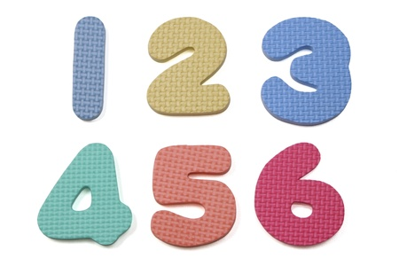 Colorful foam numbers one to six on a white background