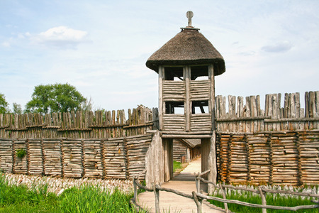 palisade: Palisade and entrance  into the old archaeological settlement in Biskupin, Poland. Editorial