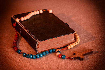 redeem: Old prayer book and rosary. Vintage style.