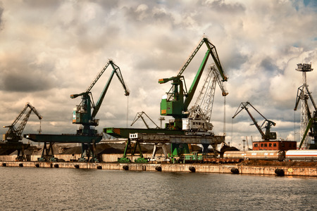 shipbuilder: Cranes at the Gdynia harbor. Cloudy day. Poland. Editorial