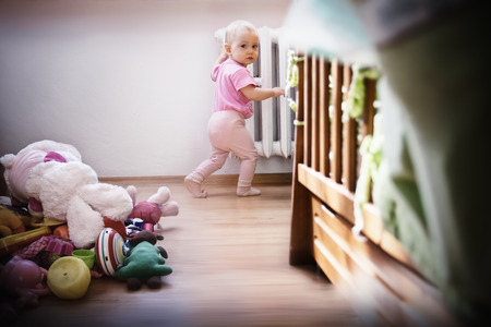 red handed: Adorable baby girl made a lot of mess, caught red handed Stock Photo