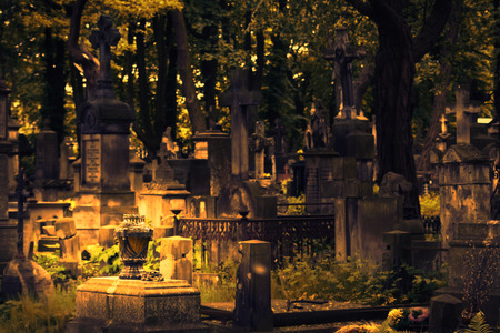 monumental cemetery: The Powazki Cemetery in Warsaw. Autumn background. Shallow depth of field. Stock Photo