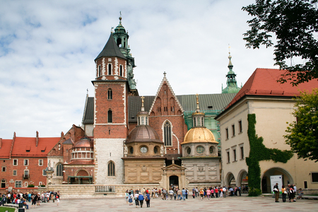 coronation: Krakow, Poland - August 13, 2011: Unidentified tourists visiting Wawel Cathedral -  Polish national sanctuary and  coronation site of the Polish monarchs.