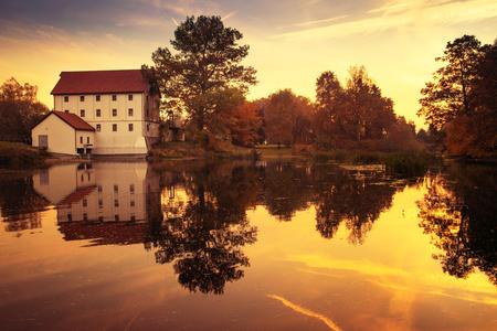 watermill: Sun rises over old watermill in Straduny. Masuria, Poland.