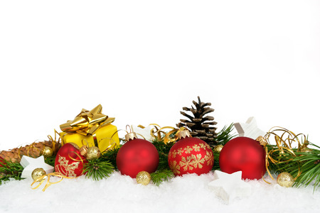 christmas backdrop: Christmas lower decoration with balls, stars, cones and gift on white background.