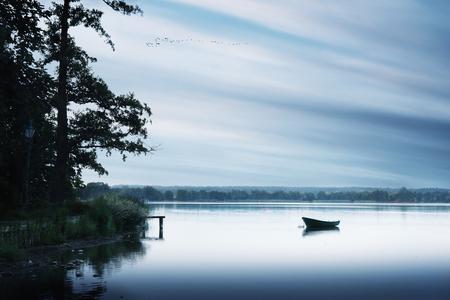 masuria: Rowing boat floating over the Lake Elk waters. Masuria, Poland.