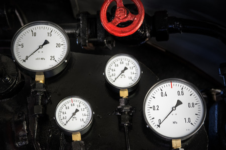 depth measurement: Pressure gauges in the old steam locomotive. Shallow depth of field.