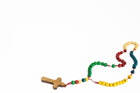 blue green background: Wooden, colorful  rosary necklace isolated on white background.