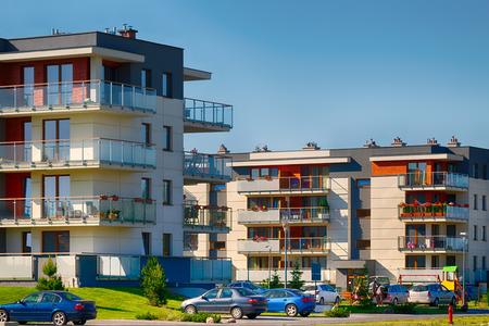 residental: Modern residental buildings of brick and glass on urban street.