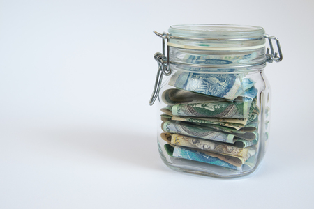stored: Money stored in a sealed retro  jar.