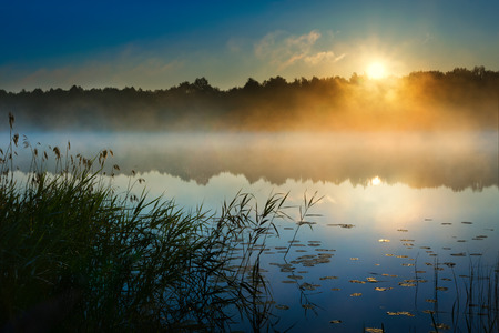 Sunrise over  Sawinda Wielka Lake. Masuria. Poland.