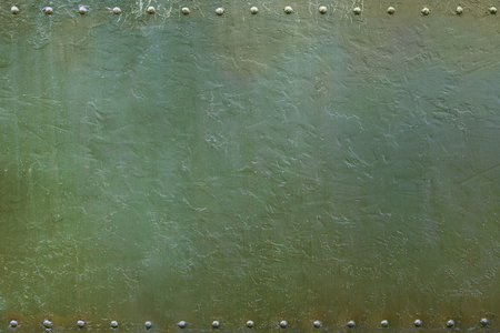 Riveted military or industrial plate. Metal background. Imagens