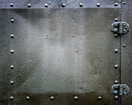 Riveted hatch plate. Metal background. Stock Photo