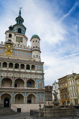 townhouses: Poznan, Poland - September 29, 2016:  Poznan Old Town with Prozerpins fountain, beautifully decorated facade of the city hall and numerous townhouses.