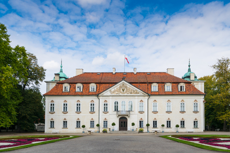 Nieborow, Poland - September 30, 2016: Back view of Radziwill family palace of Nieborow, in baroque style, surrounded by a french garden. Editorial
