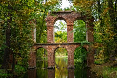 Arkadia, Poland - September 30, 2016: Aqueduct in the sentimental and romantic Arkadia park, near Nieborow, Central Poland, Mazovia. Garden in the style Angielski Stock Photo