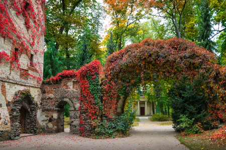 Arkadia, Poland - September 30, 2016, stone arch in the sentimental and romantic Arkadia park, near Nieborow, Central Poland, Mazovia. Garden in the style Angielski