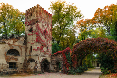 Arkadia, Poland - September 30, 2016, Burgraves house and stone arch in the sentimental and romantic Arkadia park, near Nieborow, Central Poland, Mazovia. Garden in the style Angielski