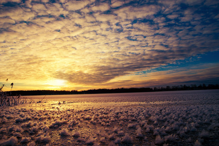 masuria: Pieces of frost on frozen Lake Elckie, lit by the setting sun. Winter landscape. Masuria, Poland.