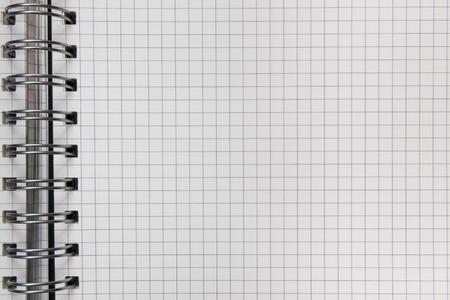 workbook: Open workbook. Checkered office background.