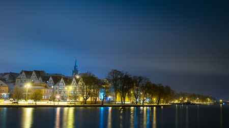 townhouses: Elk winter panorama. Night photo. Masuria, Poland. Stock Photo