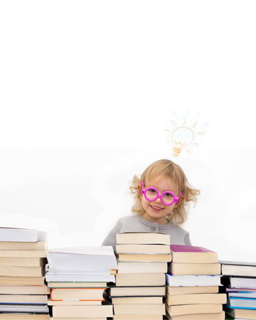 Three year old girl in pink glasses got an idea. Isolated on white.
